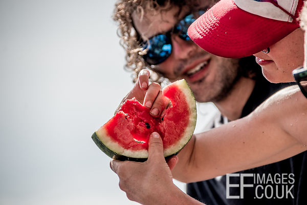 Two People Sharing A Watermelon