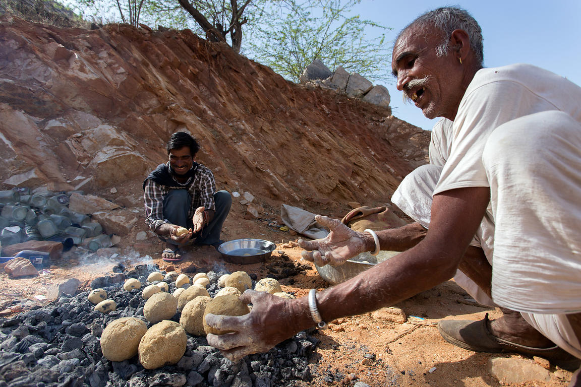 Men prepare roti for a wealthy Rajput family in Banwal village, Rajasthan, India