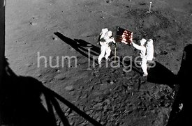 20 Jul 1969- Astronaut Neil A. Armstrong, stands on the left at the flag's staff. Astronaut Edwin E. Aldrin Jr., also picture...