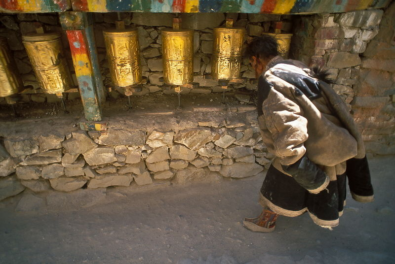 Pilgrim and prayer wheels