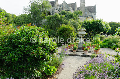 The Leisure Garden planted with a mix of shrubs including clipped box, roses and lavender. Rodmarton Manor, Rodmarton, Tetbur...