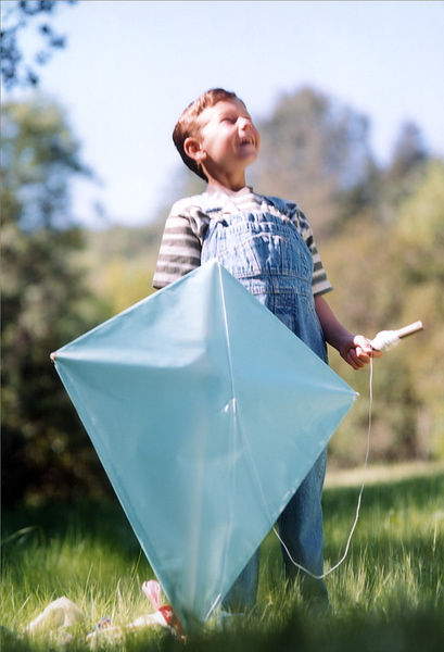 boy is ready to fly a kite