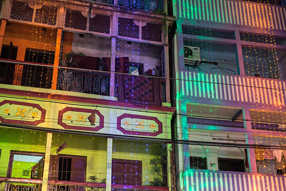 Colored lights on buildings in Sovabazar, Kolkata, India, during the Durga Puja festival.