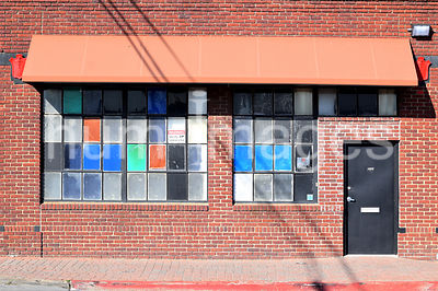 Colorful Windows on Old Red Brick Building in Deep Ellum Area of Dallas, Texas