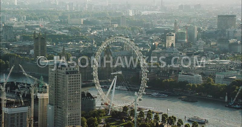 London Aerial Footage of the London Eye towards the House of Parliament