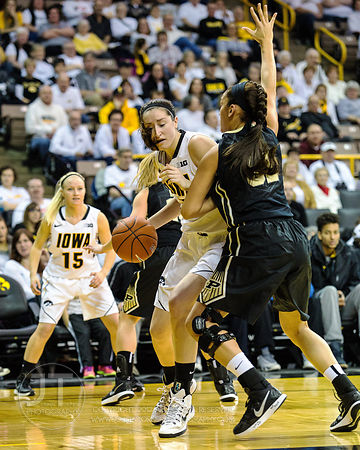 Iowa's Bethany Doolittle (51) drives the lane against Purdue's Whitney Bays (32) during the second half of play at Carver-Haw...