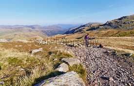 A hiker walking up from Seathwaite, Grains Gill  in the English Lake District. UK.