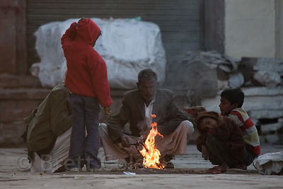 Warming up at a trash fire on a cold winter morning in Jodhpur, Rajasthan, India