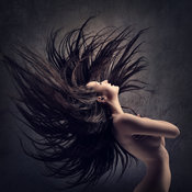 Woman waving long dark hair