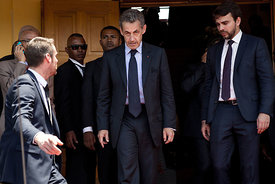 Former French President Nicolas Sarkozy (C) leaves Andry Rajoelina's inauguration ceremony as President of the Republic of Ma...