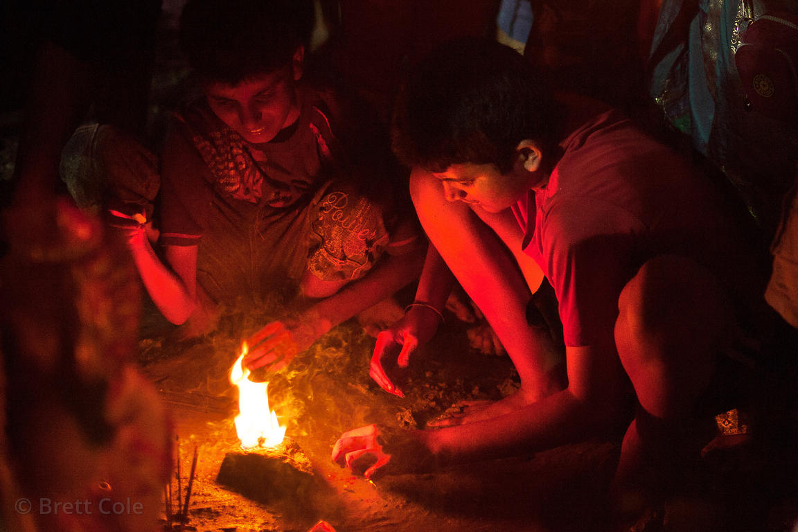 A family from Lalbaug, Mumbai, India performs puja (prayer) to Ganesh on Chowpatty Beach, during the Ganesh Chaturthi festival.