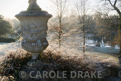 Urn at the top of lawn that sweeps down to the lake from the house. Kingston Maurward Gardens, Dorchester. Dorset, UK
