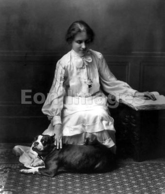Helen Keller with dog and Braille book