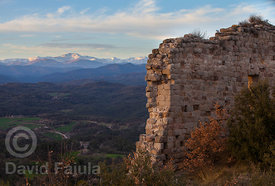 Ruins of Castle of Lluçà (Castell de Lluçà) with the Puigmal and the Pyrenees in the background