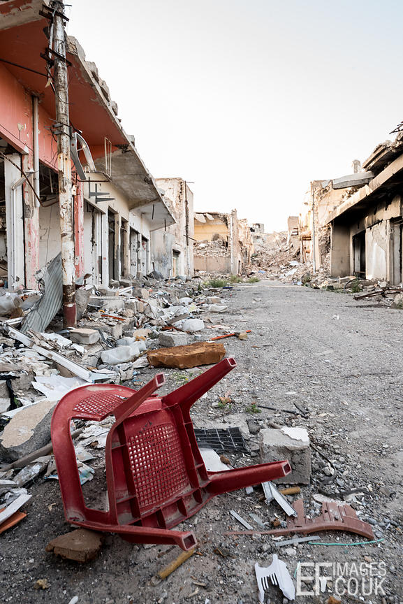 A plastic chair has escaped relatively unscathed on a destroyed street in Sinjar, eighteen months after the city was liberate...