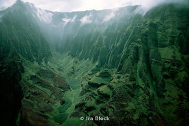 Napali Coast- Knife-edged cliffs and overgrown gorges drop to the sea 4,000 feet below. Mist and cloud cover roll in and out ...