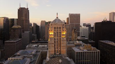 Wide Shot: Sunset Over The Board Of Trade & Financial District