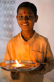 A boy collects donations for having his photo taken during the Pushkar camel fair, Pushkar, Rajasthan, India. I photographed ...