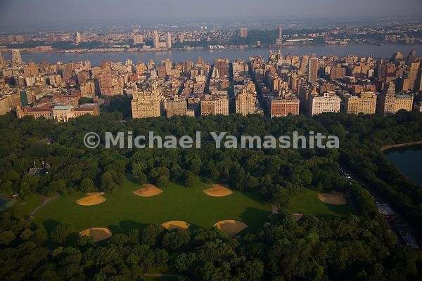 New Yorkers take time out from commerce to play ball: Central park has 26 ball fields - eight are on the Great Lawn.  Manhatt...
