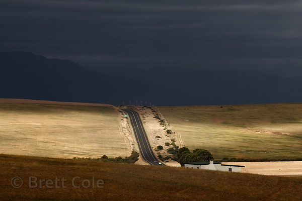 Late light on rolling hills in farmland near Swellendam, South Africa