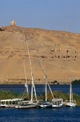 View of the West bank of the Nile with the 'Tombs of the Nobles' in the cliffs, Aswan, Egypt