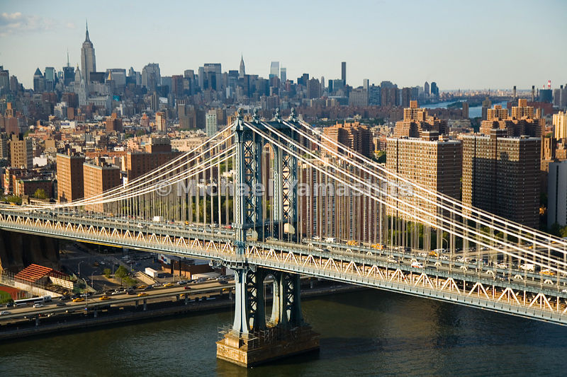 An aerial view of the Manhattan Bridge in New York City, with the borough of Manhattan in the background.