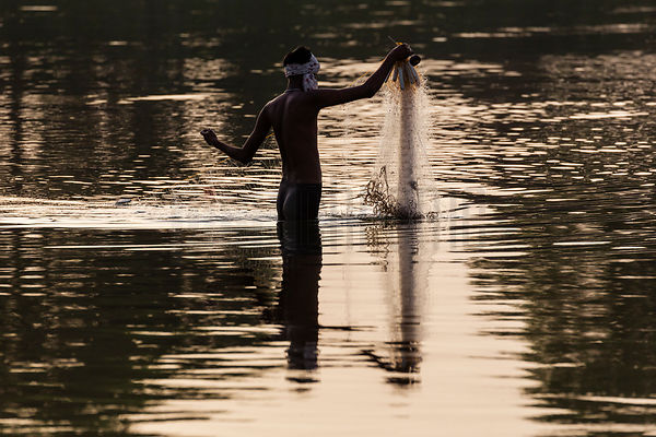 Fisherman Pulling in his Nets