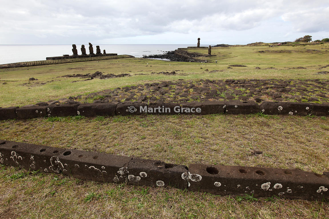 Hare Paenga (boat-shaped house foundations), Tahai, Easter Island with the five Vai Uri moai behind