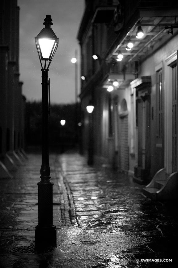 PIRATE'S ALLEY RAINY DAY FRENCH QUARTER NEW ORLEANS BLACK AND WHITE VERTICAL