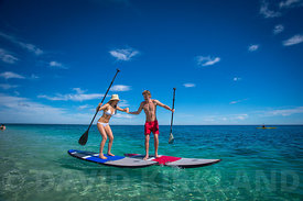 Couple having fun on the water at Coral Bay, Western Australia