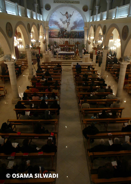 Palestinian Catholic mourn the death of Pope John Paul II at  the Holy Family Church in the West Bank City of Ramallah
