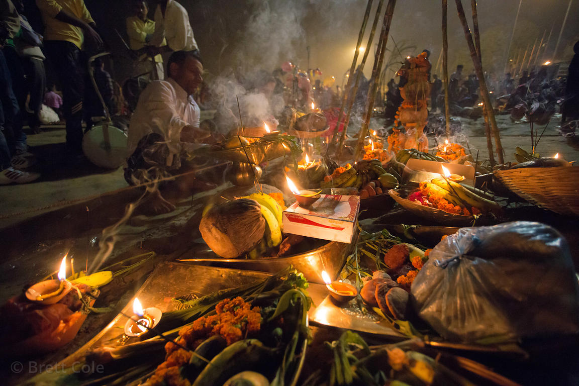 Offerings on the banks of the Ganges River during Chhath Puja, Varanasi, India. Chhath Puja is a devotion to the Sun God Sury...