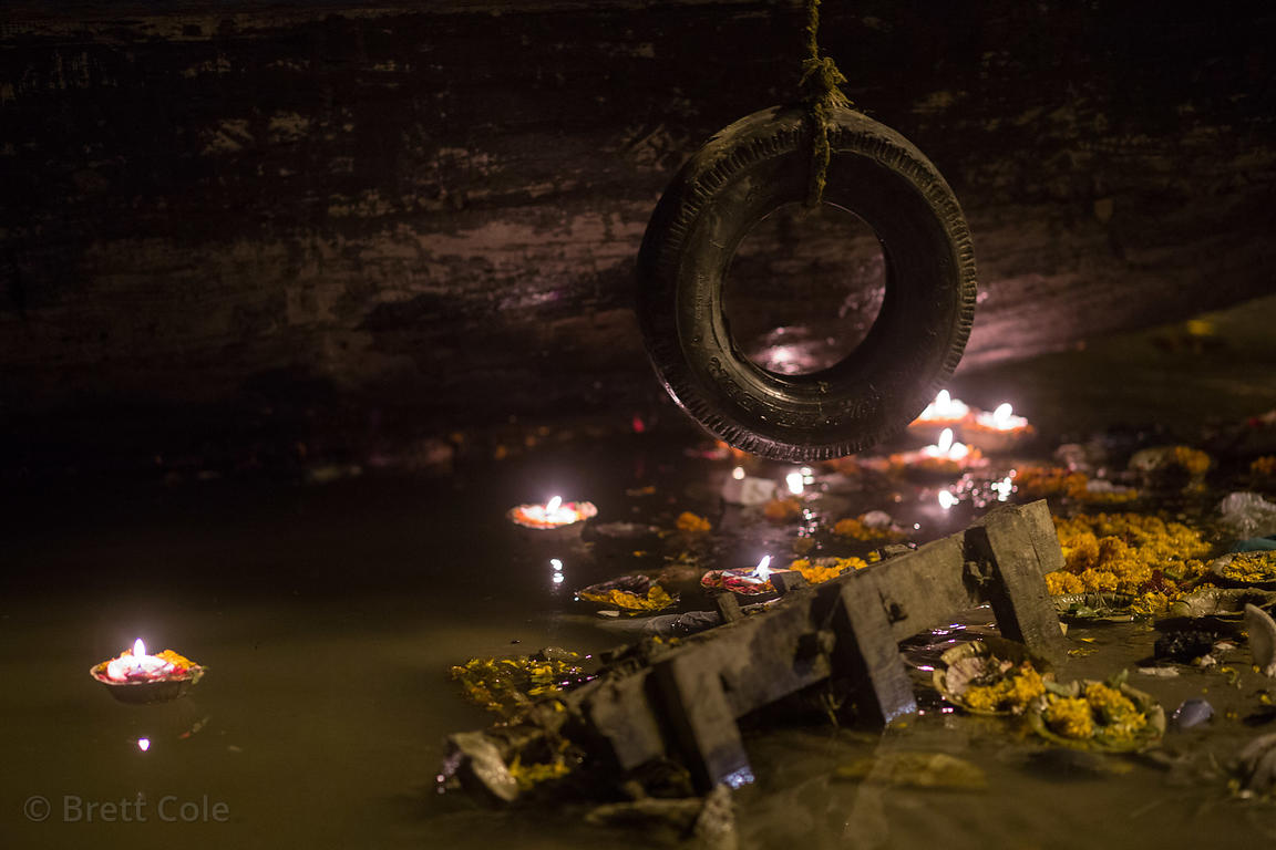 Organic garbage and candles in the Ganges River at night, Dashashwamedh Ghat, Varanasi, India