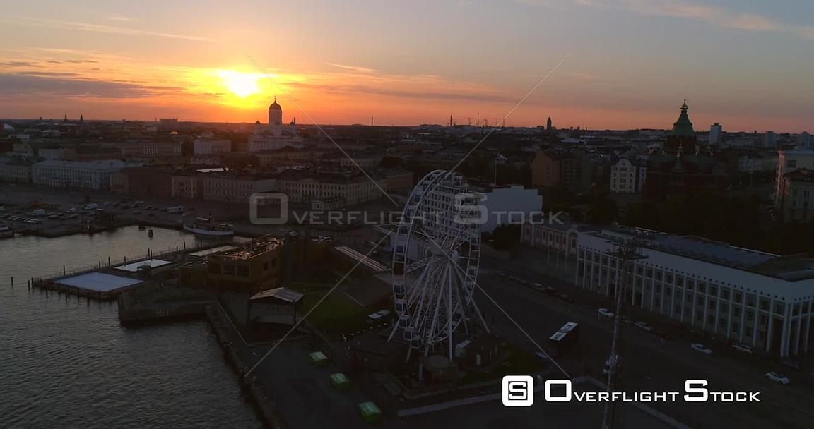Sunset City, Aerial Sideway View of the South Harbour, the Helsinki Skywheel Ferris Wheel and the Market Square , on a Sunny ...