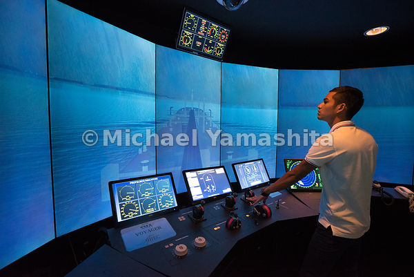 At the Singapore Maritime Academy's fully integrated simulation center, a cadet undergoes training inside a simulated navigat...