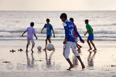 A soccer game at dusk on Juhu Beach, Mumbai, India.