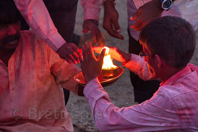 A family from Mumbai, India performs puja (prayer) to Ganesh on Chowpatty Beach, during the Ganesh Chaturthi festival.