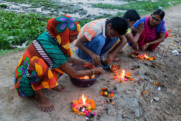 Family Sending Blessings on the Yamuna River