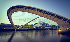 NEWCASTLE UPON TYNE, ENGLAND, UK - MAY 08, 2018: The Gateshead Millennium Bridge over the Tyne opening from the Newcastle Qua...
