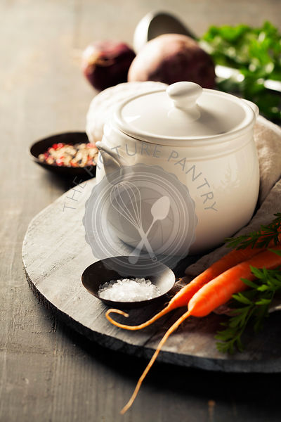 Cooking pot and vegetables for making vegetable soup on rustic background