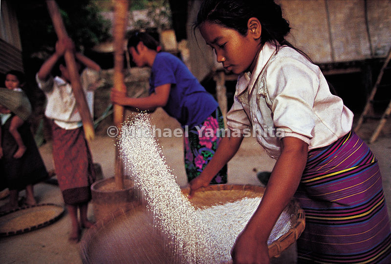 Rice sifting in Pak Beng, a village not far from the Mekong river's big Laotian loop.