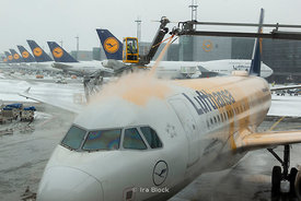 A scene of Lufthansa airlines plane being deiced at Frankfurt airport in Frankfurt, Germany