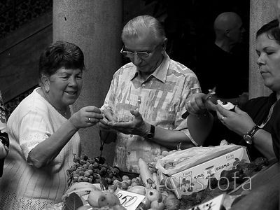 visitors try things in the Funchal covered market, Mercado dos Lavradores