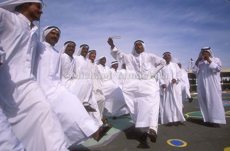 A group of dervishes celebrates the 62nd birthday of Saddam Hussein in Tikrit.