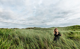 Girl with magnifying glass in Danish dunes 6
