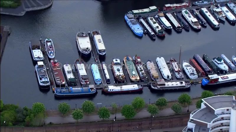 Aerial footage of boats docked in Canary Wharf, London, England, UK