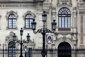 Detail of government palace entrance facade and ornate street lamp, Plaza de Armas, Lima, Peru
