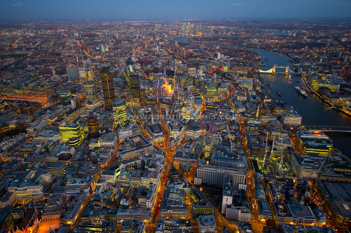 Aerial view over Bank at night. London