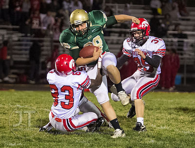 Iowa City West's Orion Phillips (38) runs with the footbal into defending Iowa City High player Tieron James (83) during the ...