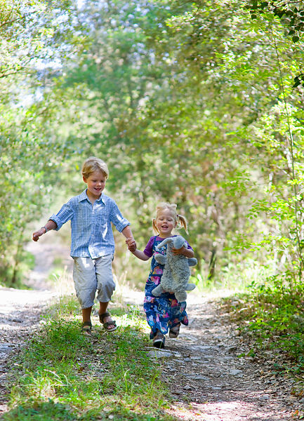 Children walking hand-in-hand outdoors